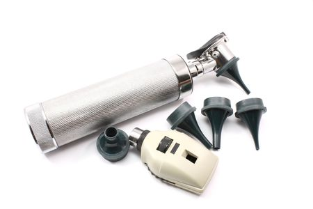 opthalmascope: Silver otoscope and opthalmascope with ear attachments photographed on a white background
