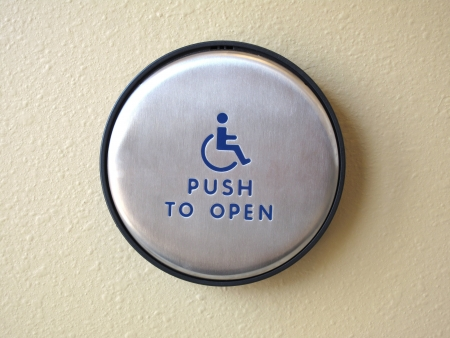 Photo of a disabled door push to open button