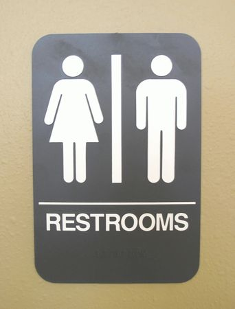bathroom sign: Unisex bathroom sign photographed on a white background Stock Photo