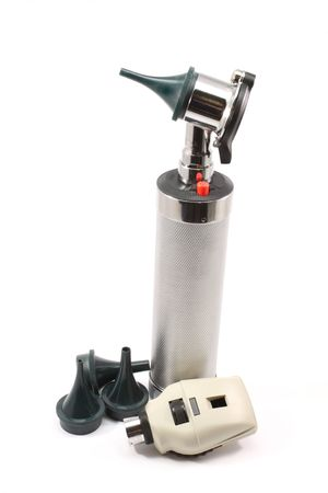 opthalmascope: Upright silver otoscope and opthalmascope with ear attachments photographed on a white background