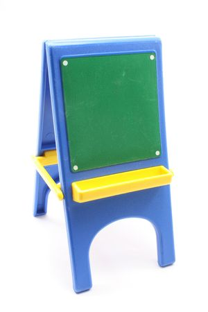 A small toy black board on an easel.