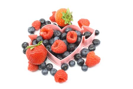 Heart healthy fresh berries, blueberries, raspberries, strawberries with heart shape. Stock Photo - 5733901