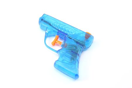 Blue plastic toy squirt gun photographed on a white background photo