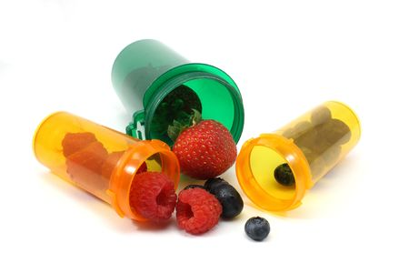 Assortment of berries spilling out of pill bottles as if the berries are medications photogrpahed on a white background Stock Photo - 5745330