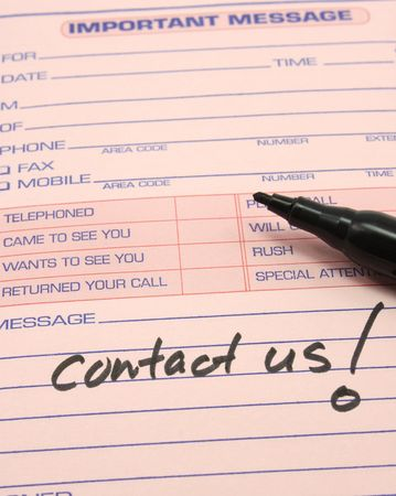 Contact Us written on a pink phone message pad with a black felt pen. Stock Photo