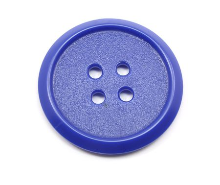 Big blue plastic button photographed on a white background photo