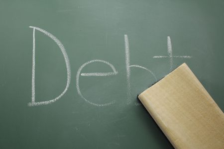 The word debt on the chalkboard is being erased showing concept of erasing debt. Stock Photo - 6663491