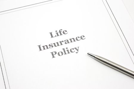 insurance policy: A life insurance policy with a pen to sign.
