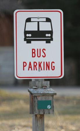 sign stating Bus Parking with a bus pictured. photo