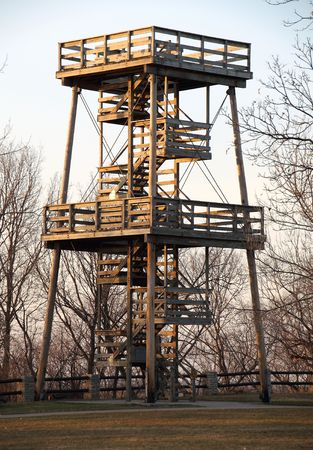 acres: A huge fire watch tower or ranger station overlooks hundreds of acres of forest. Stock Photo
