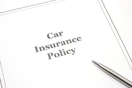 liability insurance: A car insurance policy with a pen ready for signing. Stock Photo