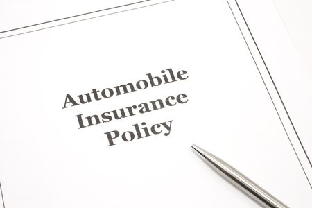 An automobile insurance policy with a pen ready to be signed. photo