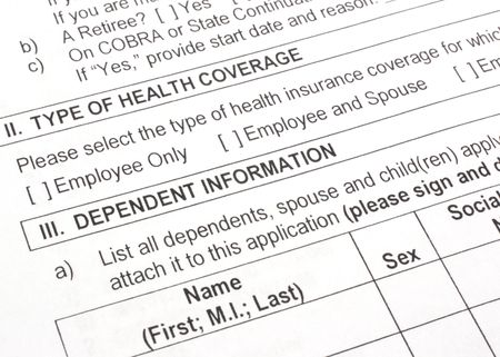 Close-up photograph of an employee group health insurance application form. photo