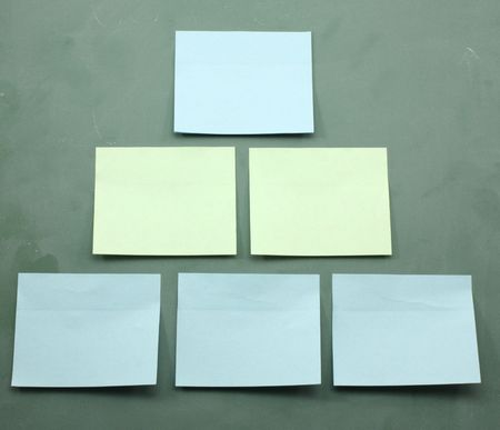 Sticky notes on a blackboard in a pyramid that could be used as an organization chart. Stock Photo - 6761561