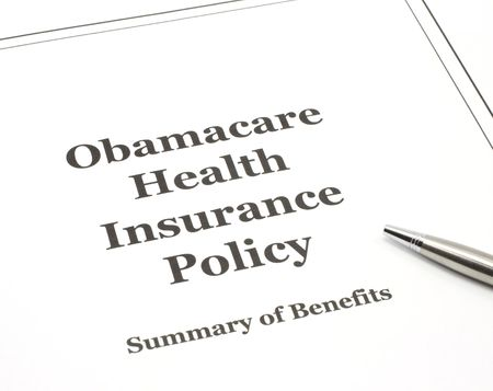 Obamacare government health care insurance program policy with a pen ready to be signed.