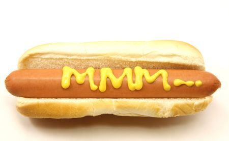 weenie: A Foot Long Hot Dog and Bun with MMM... written on it in mustard.