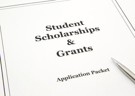 scholarship: A college scholarship and grant application packet with a pen ready to start. Stock Photo