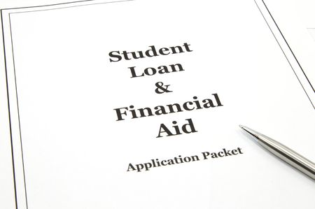 university application: A student loan and financial aid college application packet with a pen ready to start.