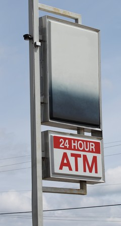 A 24 hour ATM sign with black space above for your writing or logo. photo