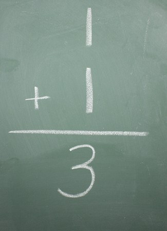 One plus one equals three written on a blackboard. Stock fotó