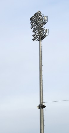 ballpark: A stadium light against a blue sky at a baseball outdoor stadium ballpark.