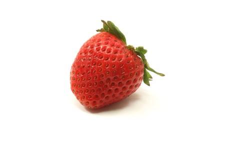 A single strawberry on a white background. Stock Photo - 6989205