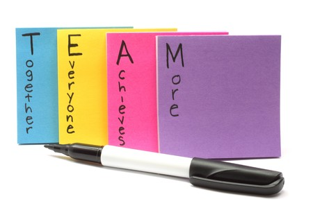 A black felt marker pen with Team together everyone achieves more. Stock Photo - 6989209