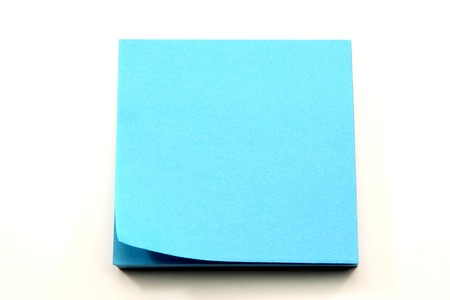 A stack of aqua blue sticky notes with the corner curling ready to be torn off and used. Stock Photo - 7806011