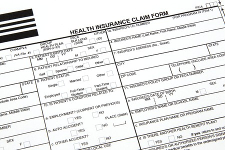 hmo: A health insurance claim form ready to be filled out for manual submission to an insurance carrier.