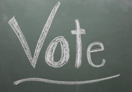 Vote written on blackboard in white chalk and underlined. Stock Photo - 7848265