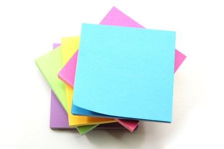 5 pads of sticky notes stacked on top of one another photographed on a white background Stock Photo - 8145208