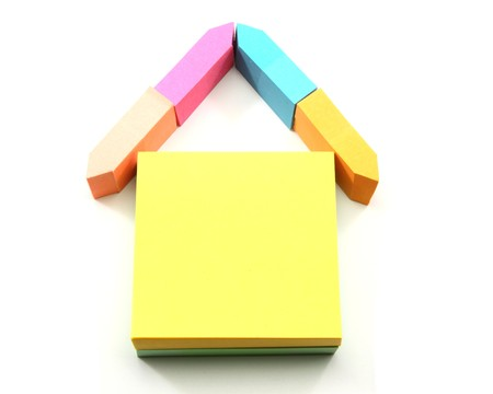 A colorful house made out of different shaped sticky notes. Stock Photo - 8158681