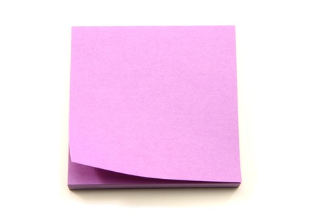 A purple sticky note pad with one piece curled up. Stock Photo - 8158689