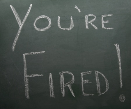 Youre Fired written on a blackboard with white chalk.