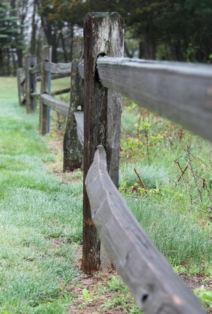split rail: A close up shot looking down a wooden split rail fence.