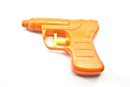 desencadenar: Un ca��n de la pistola de juguete naranja con un desencadenador de amarillo.
