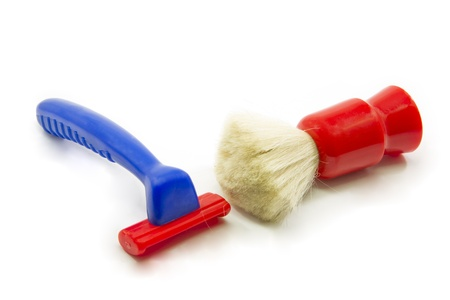 Childs blue and red toy shaving kit with a toy razor and foam brush.