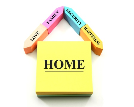 A colorful home or house concept made out of different shaped sticky notes with home, happiness, family, love, and security labels. Imagens