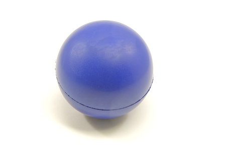 A blue sponge stress reliever ball on a white background.