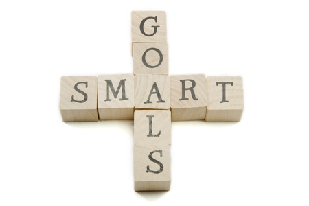Smart Goals spelled out on wooden blocks showing smart concept. Stock Photo - 9356972
