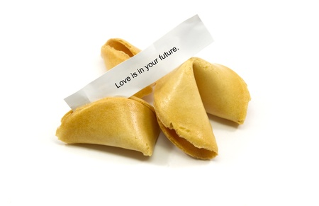 biscuits: Chinese fortune cookies cracked open with the fortune Love is in your Future.