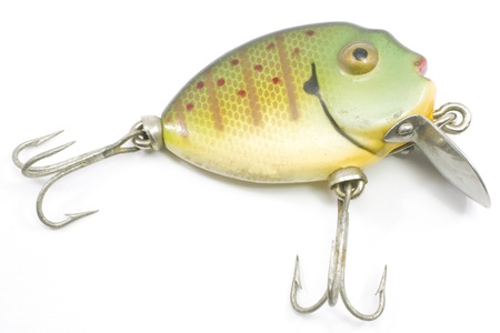 An antique fishing lure in the shape and color pattern of a punkinseed.