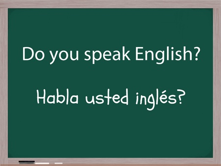Do you speak English, Habla usted ingles, written on a chalkboard.