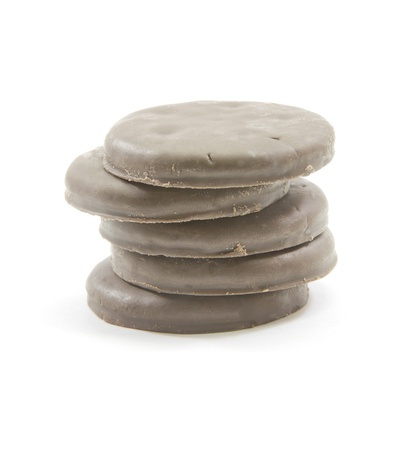 chocolate mint: A stack of chocolate mint thin round cookies piled high.