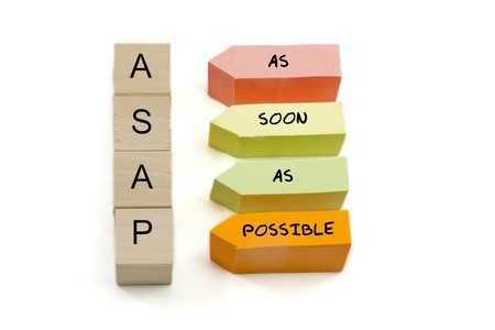 acronym: ASAP, As Soon As Possible spelled out on wooden blocks and colorful arrow shaped sticky notes.