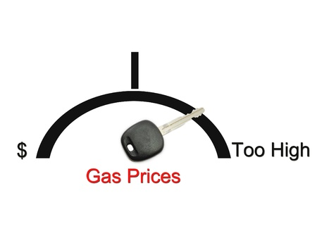 gas gauge: An automobile or car gas gauge with a key showing the concept of gas prices being too high.