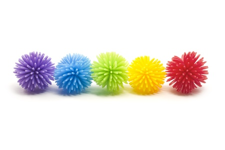 spikey: Five colorful stress balls in a line