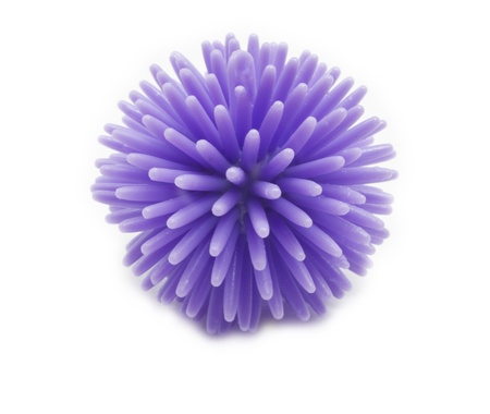spikey: A spikey purple stress ball ready to be squeezed.