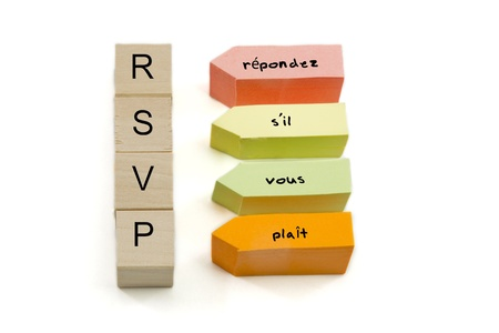 acronym: RSVP or repondez sil vous plait in French written on wooden blocks and colorful sticky notes.  Roughly translates to respond as soon as you can or very soon.