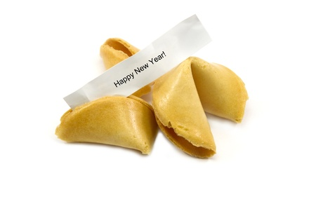 biscuits: Chinese fortune cookies with one open with the paper message Happy New Year.